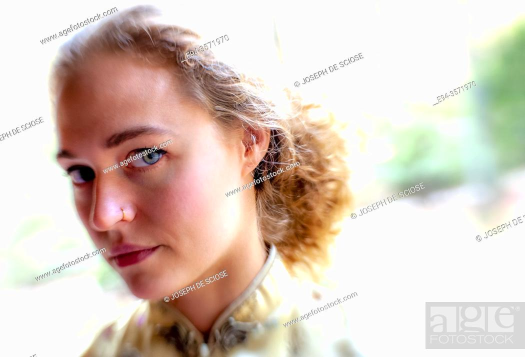 Stock Photo: A 28 year old blond woman looking at the camera.