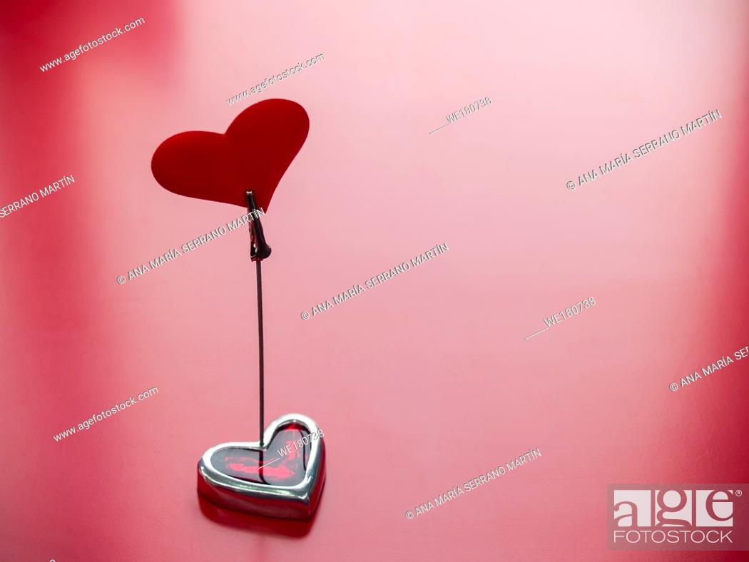 Imagen: Concept of love A stand with a red heart and red background.
