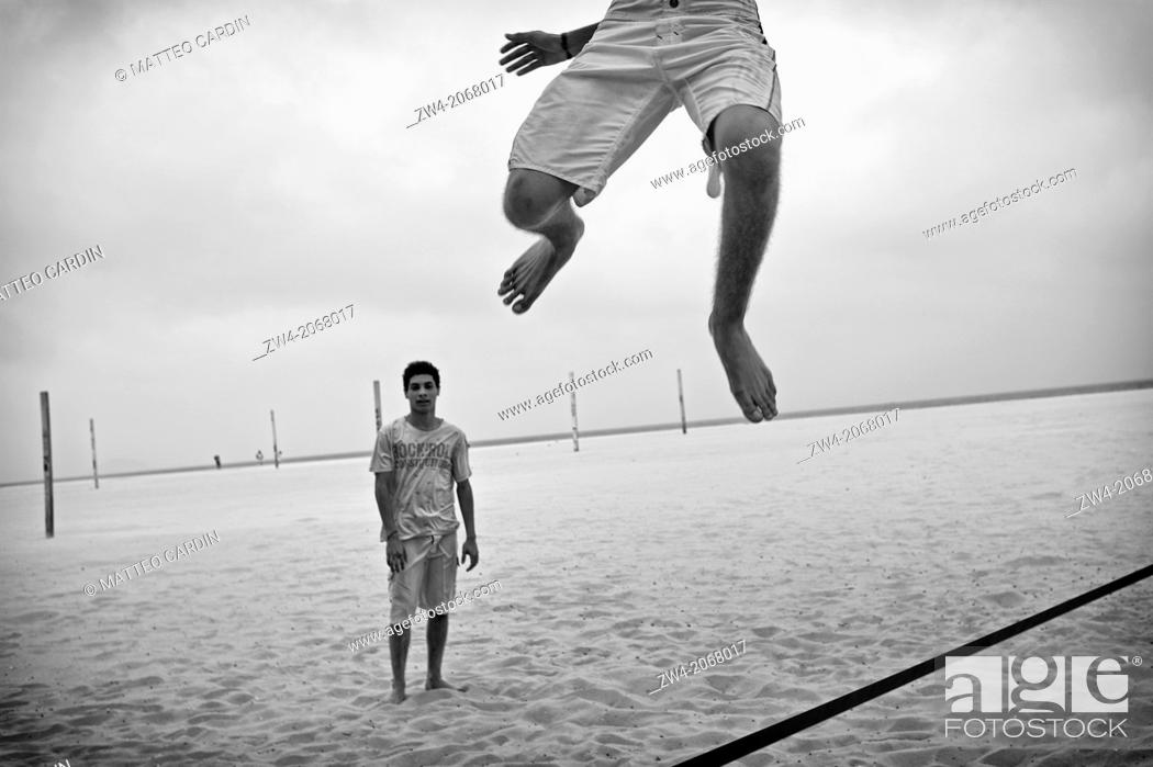 Stock Photo: Jumping on the rope in Copacabana beach.