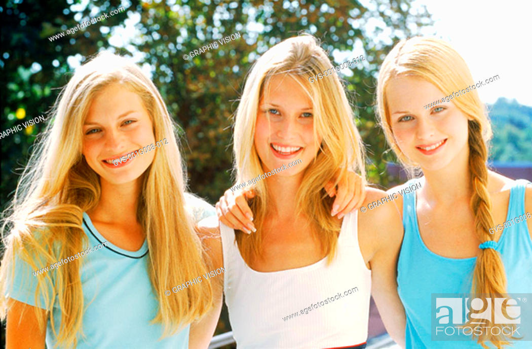 Stock Photo: Portrait of three young women.