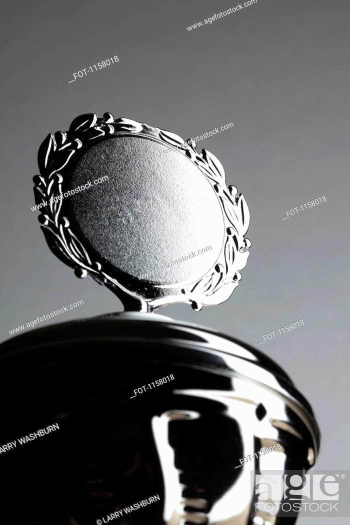 Stock Photo: Close-up of a silver trophy with blank plaque surrounded by laurel wreath.