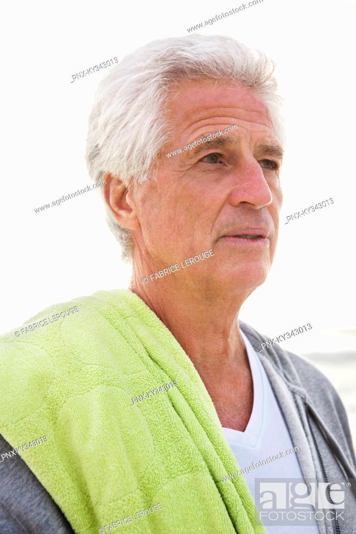 Stock Photo: Close-up of a senior man at beach.