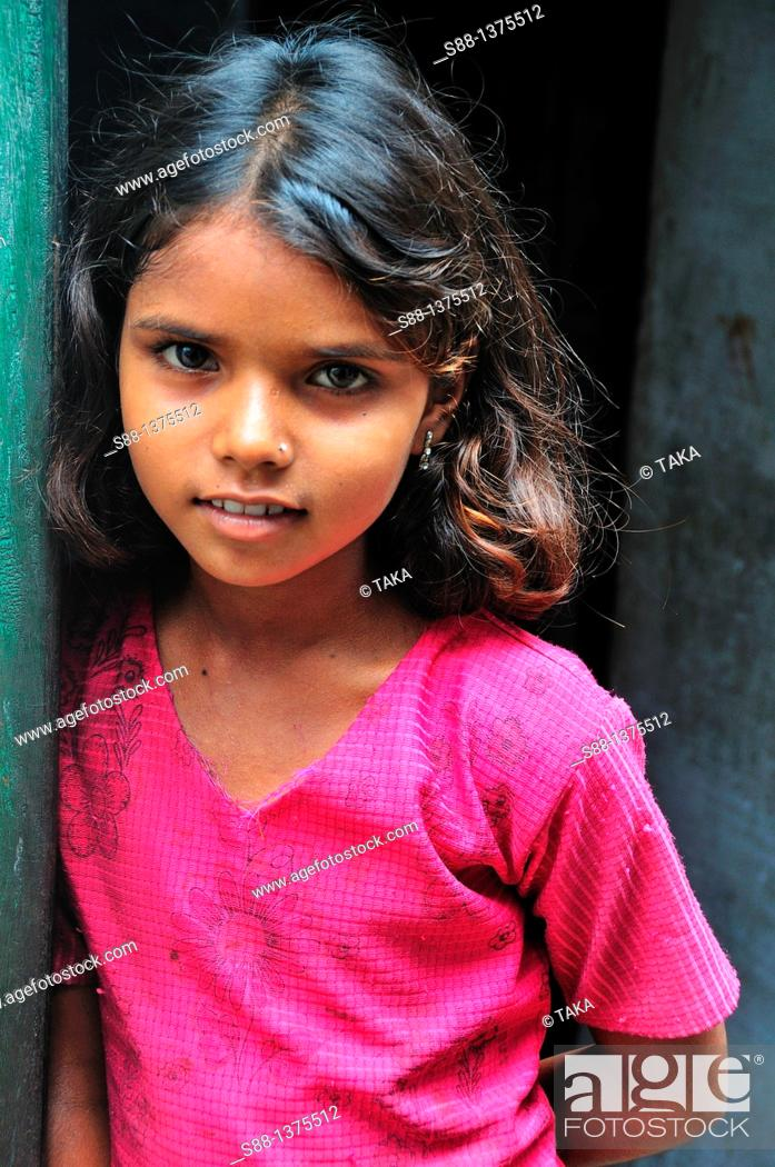Stock Photo: Young girl at narrow street of the old town near the Ganges River.