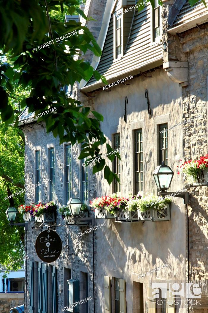 Stock Photo: Facades of Colonial-style stone buildings (one of which is plastered with cement rendering) dating back to the mid 1700s in Old Quebec City.