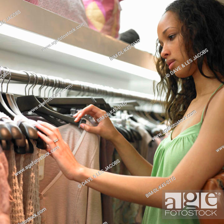 Stock Photo: Young woman clothes shopping.