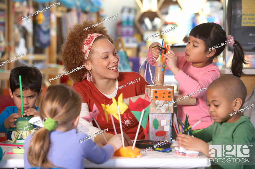 Stock Photo: African American female Art teacher with young students.