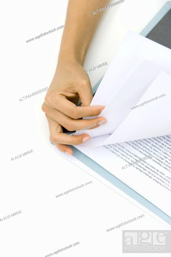 Stock Photo: Hand turning document pages, close-up.
