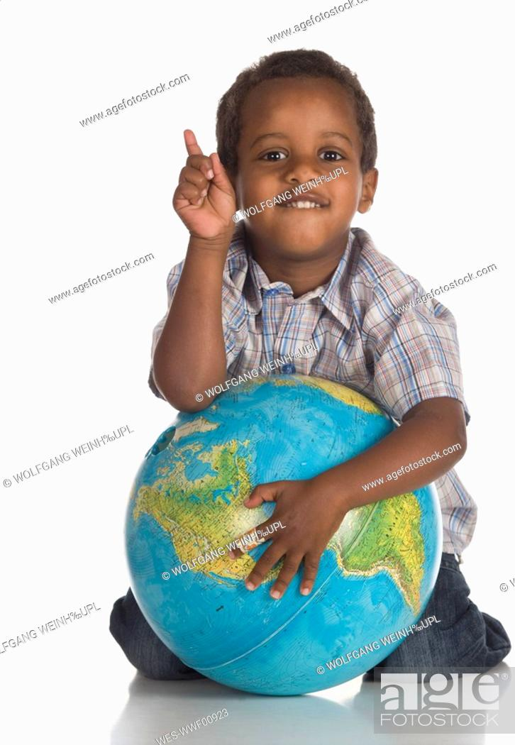 Stock Photo: African boy 3-4 holding globe, portrait.