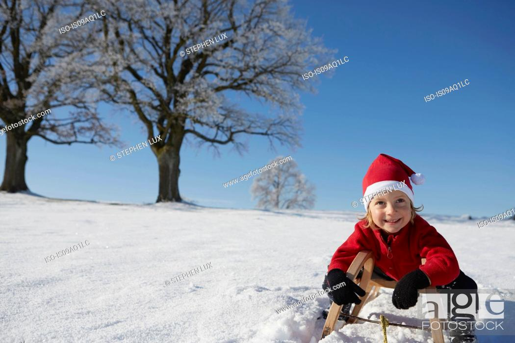 Stock Photo: Portrait of young boy on sled.