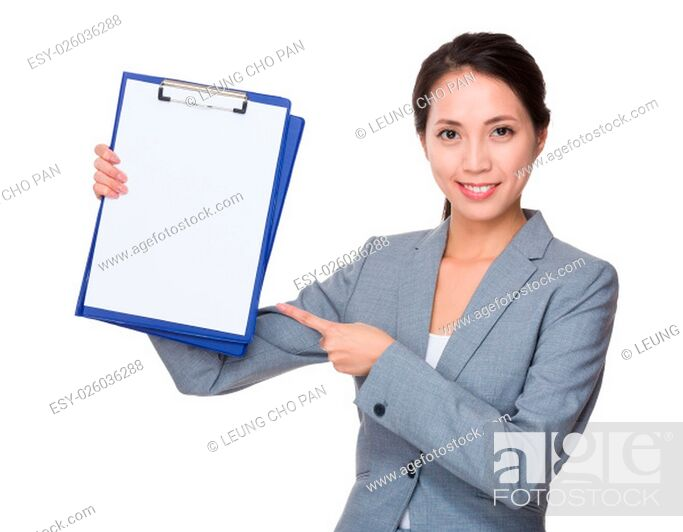 Stock Photo: Young Businesswoman showing with blank page of clipboard.