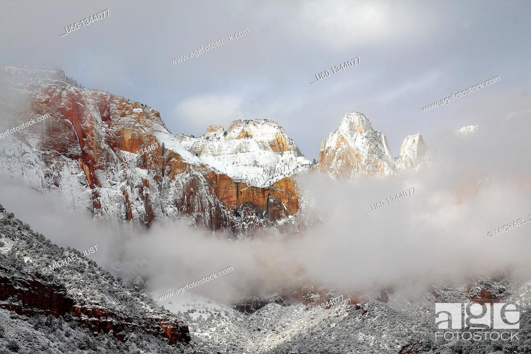 Stock Photo: Fresh snow covers the Towers of Virgin at Zion National Park, Utah, USA.