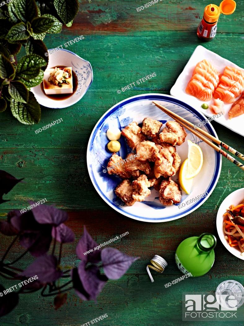 Stock Photo: Still life plate of karaage chicken with tofu, pickled ginger and lemon.