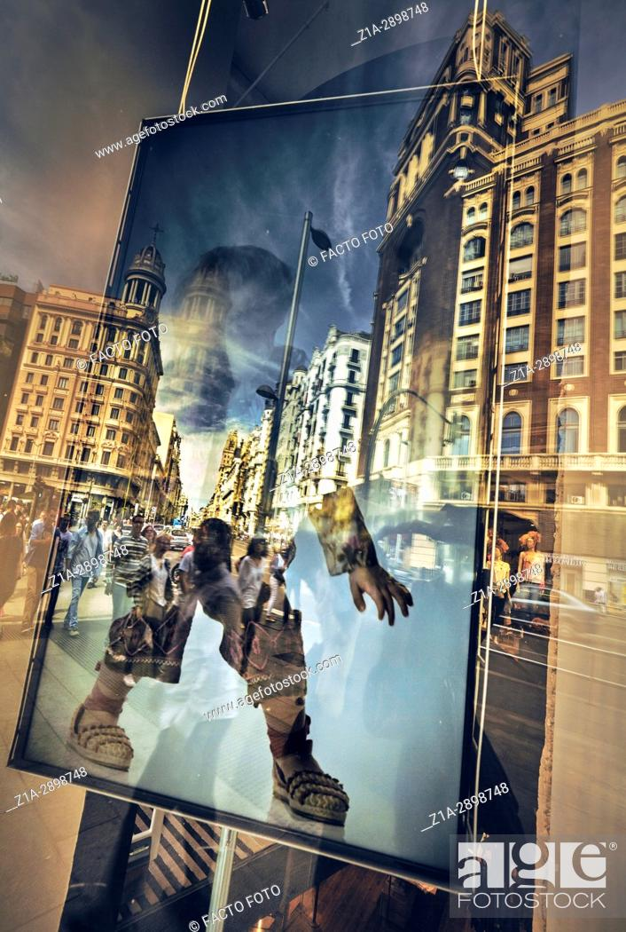 Imagen: Reflection on a window in Gran Via Avenue. Madrid. Spain.