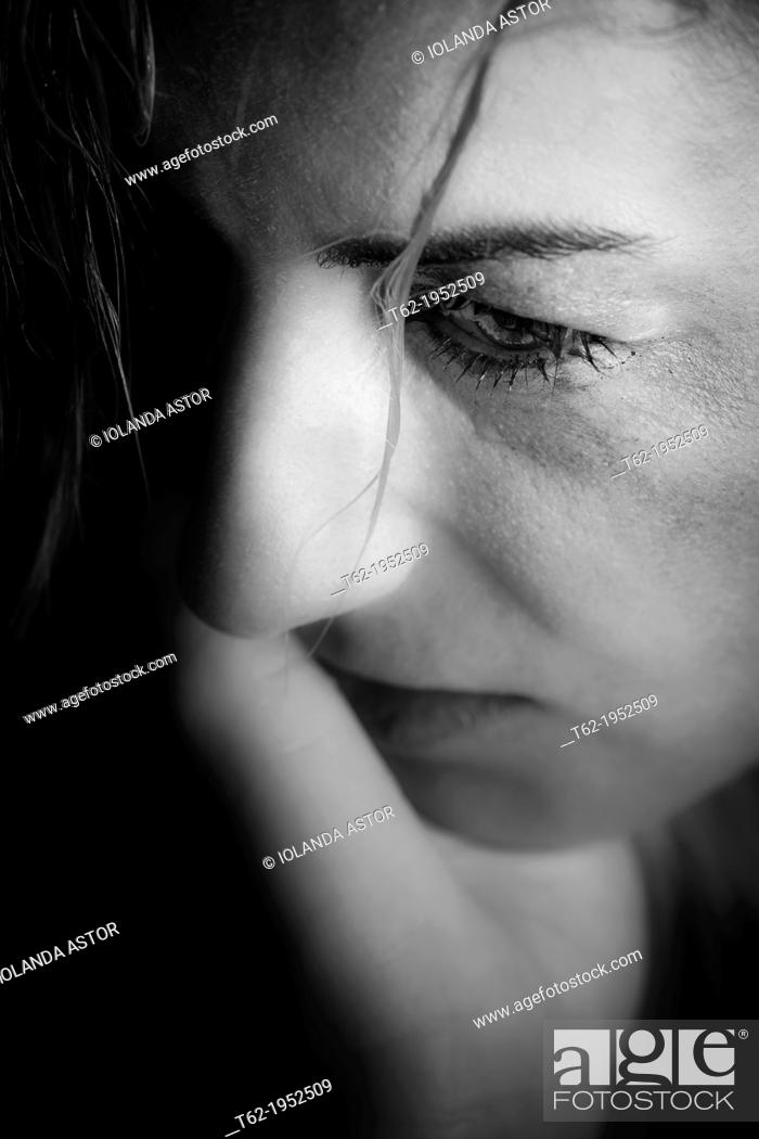 Stock Photo: Battered woman crying.