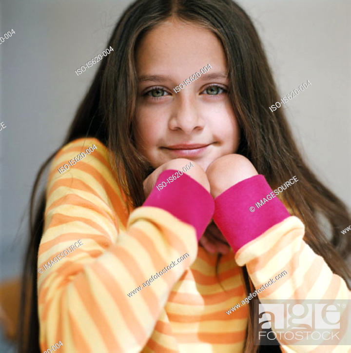 Stock Photo: Portrait of a girl wearing a striped sweater.