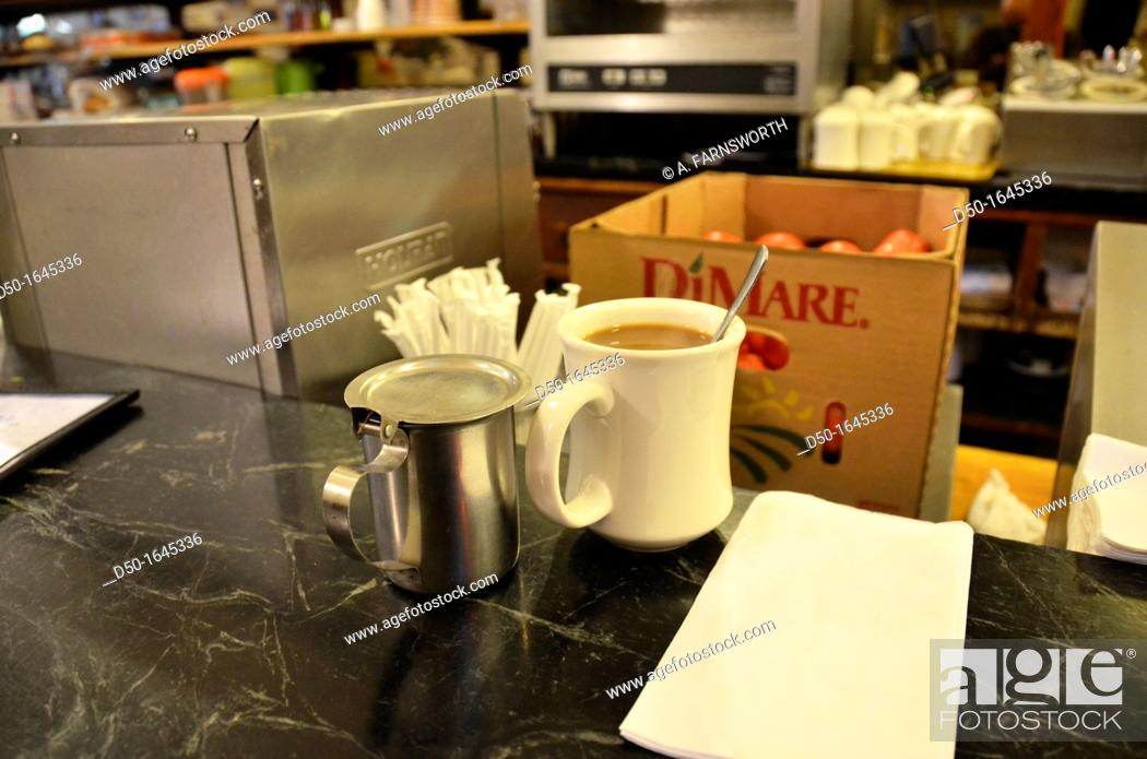 Stock Photo: Coffee cup and milk at diner, New York City, USA.