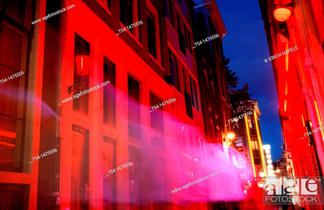 Stock Photo: Lighted Houses in the Red Light district of Amsterdam.