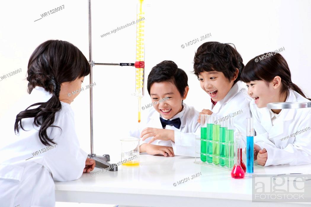 Stock Photo: kids doing chemistry.