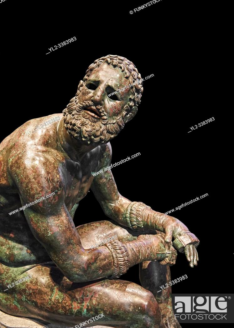 Stock Photo: Rare original Greek bronze statue of an Athlete after a boxing match, a 1st cent BC. The athlete, seated on a boulder, is resting after a boxing match.