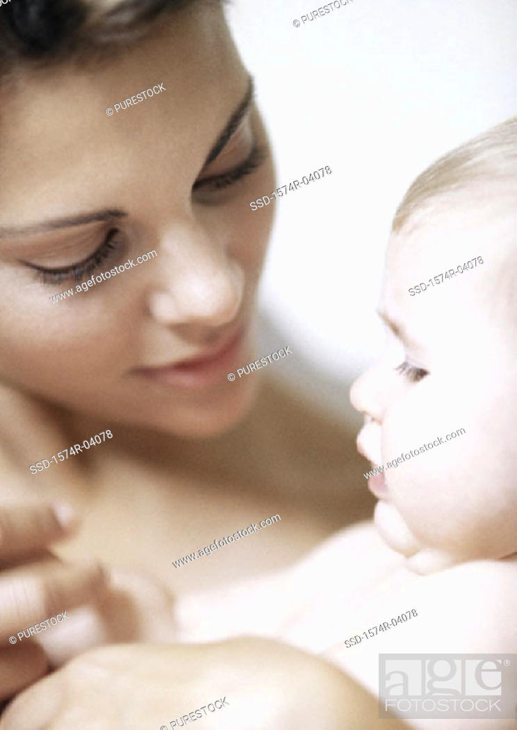 Stock Photo: Close-up of a mother holding her baby boy.