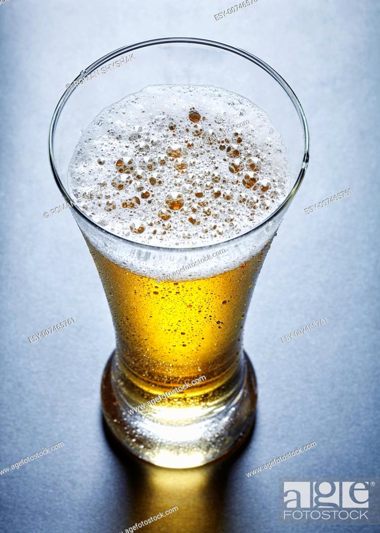 Stock Photo: glass full of beer, view from above.