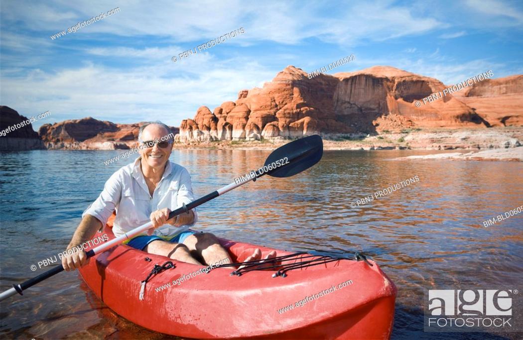 Stock Photo: Senior man sitting in kayak.