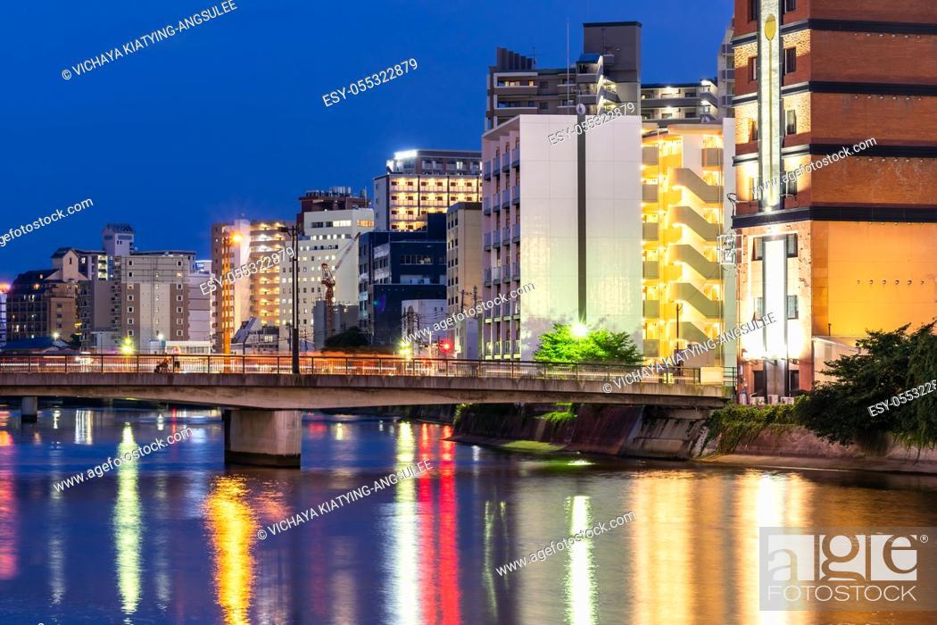 Stock Photo: Fukuoka old town along naka river at Nakasukawabata sunset twilight. This area is favorite for tourist for Fukuoka Yatai, street Food stall.