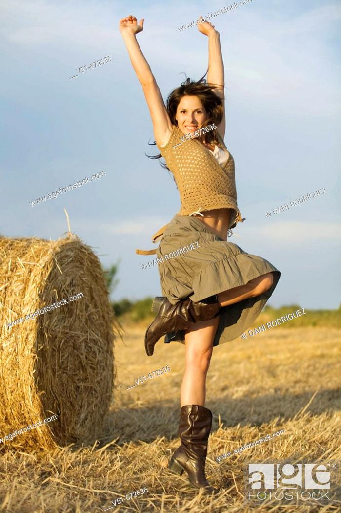 Stock Photo: Young woman jumping in the countryside.