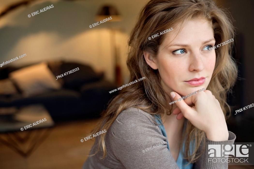 Stock Photo: Close-up of a beautiful woman thinking.