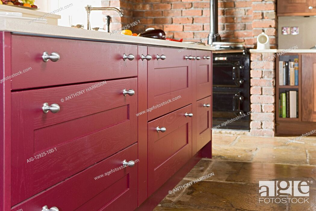 Stock Photo: Traditional frmhouse kitchen with flagstone floor and Shaker-style cupboards and drawers.
