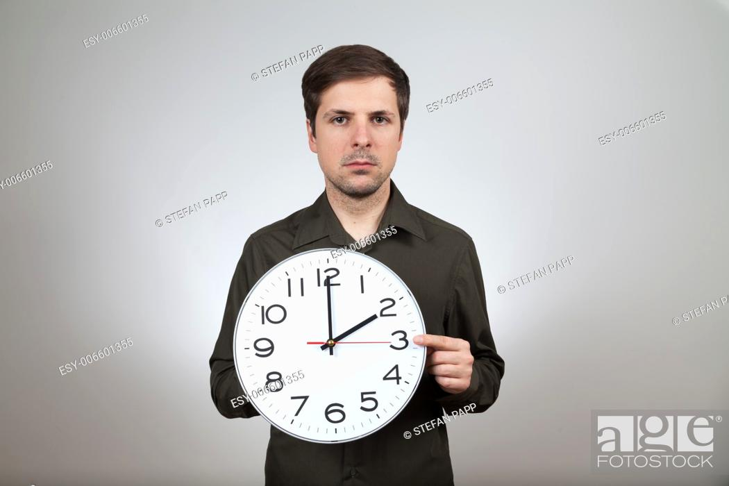 Stock Photo: man shows clock change to summertime.