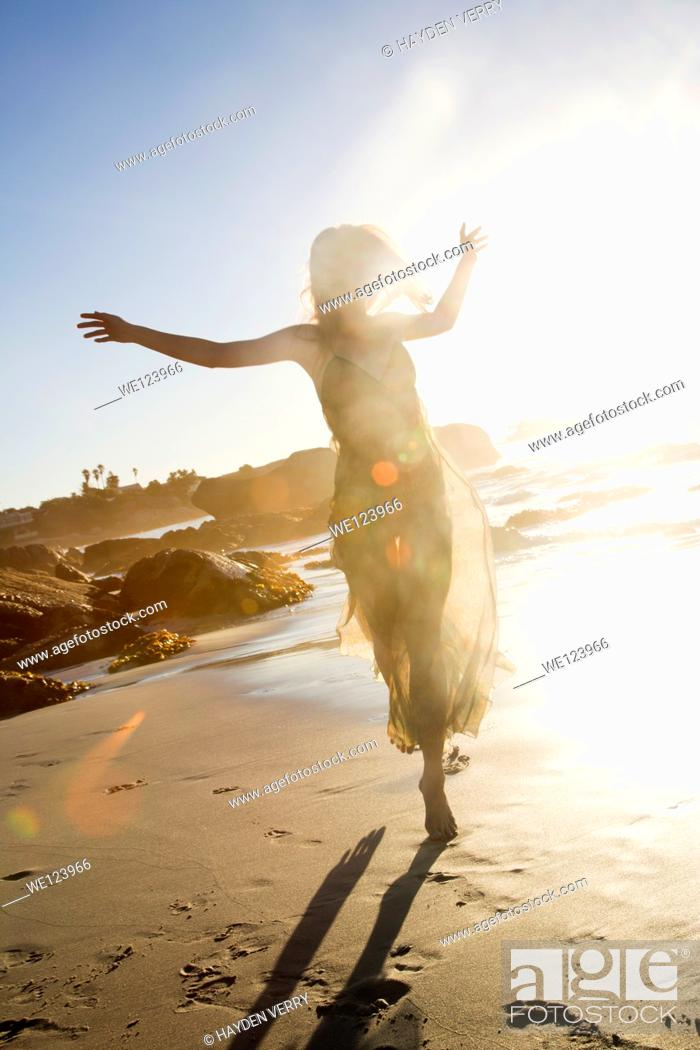 Stock Photo: Young Woman Celebrating On Beach.
