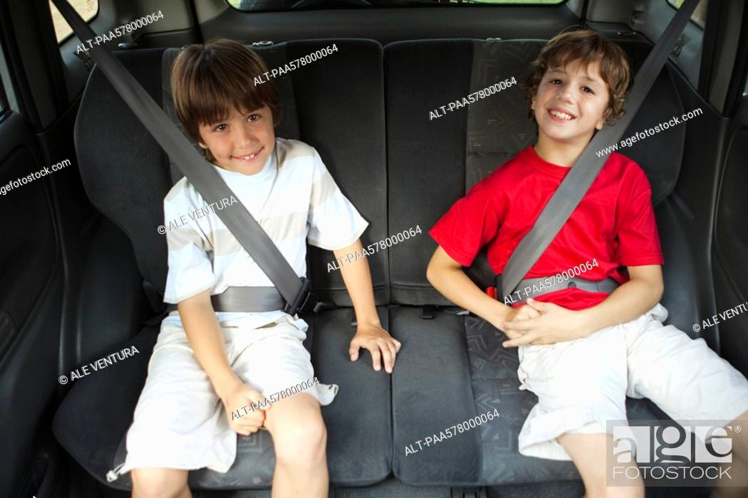 Stock Photo: Brothers sitting in car, portrait.