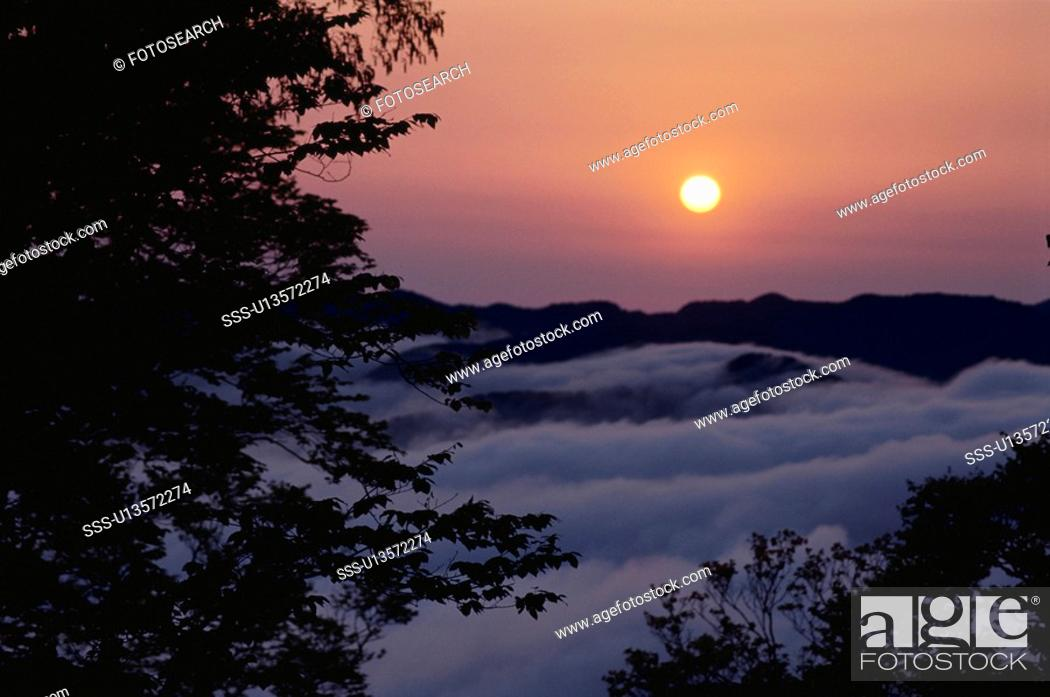 Stock Photo: The Morning Sun And A Mountain Range.