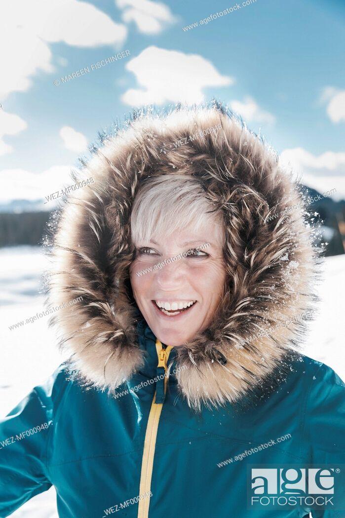 Stock Photo: Germany, Bavaria, Winklmoosalm, Portrait of smiling mature woman.