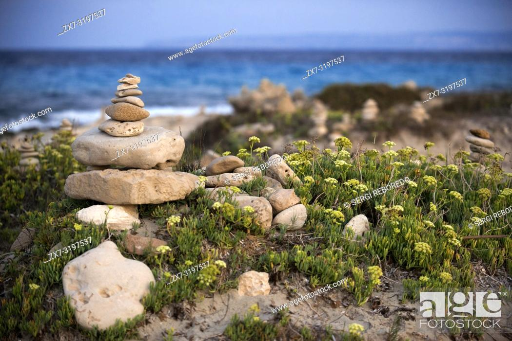 Stock Photo: Zen space. Stones. Ses Illetes Beach, Balearic Islands, Formentera, Spain. Backlights in the sunset with stones with different shapes.