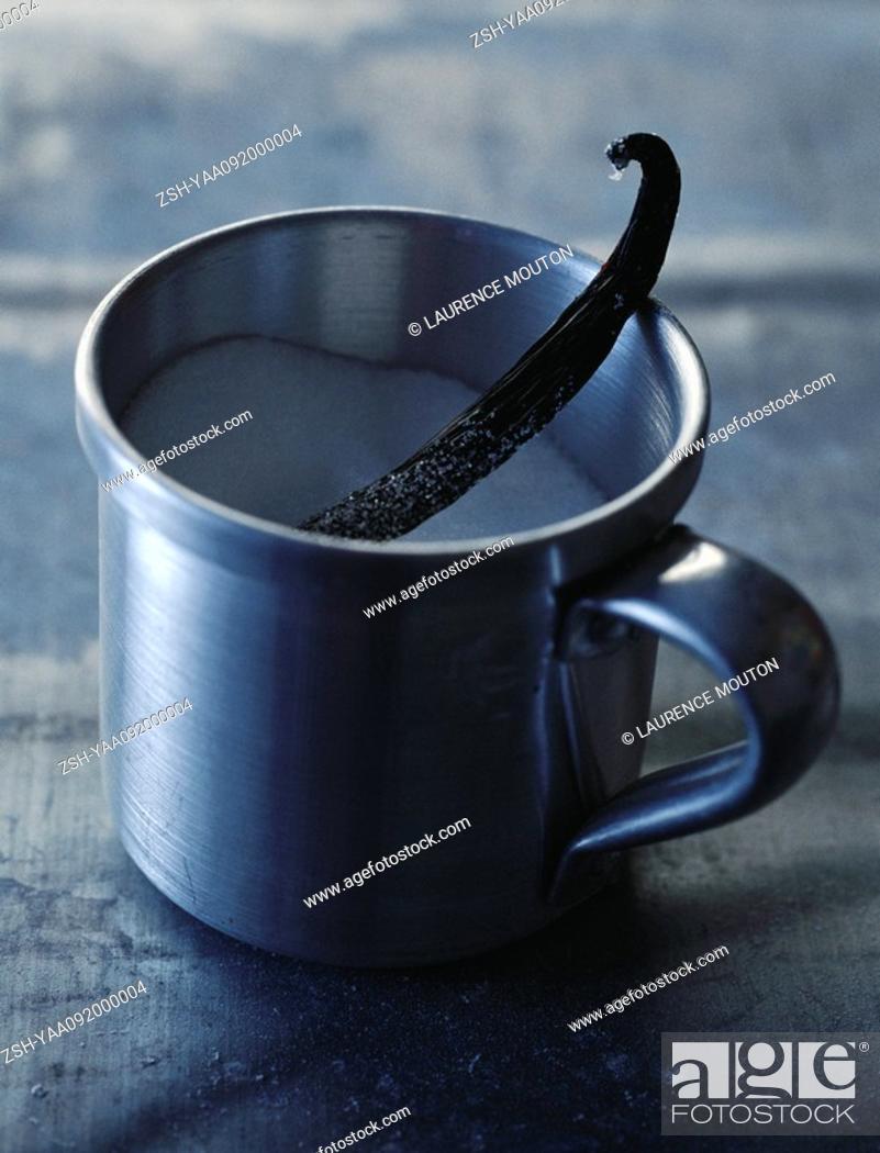 Stock Photo: Mug of sugar with vanilla pod.