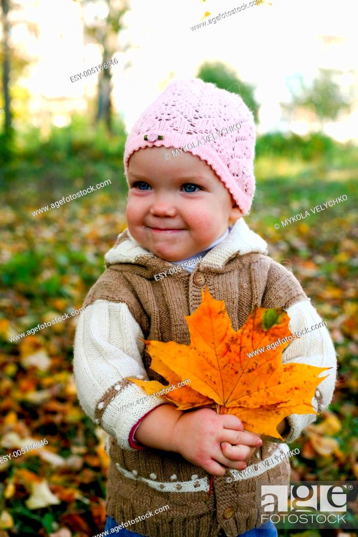 Stock Photo: Nice baby with leaves.