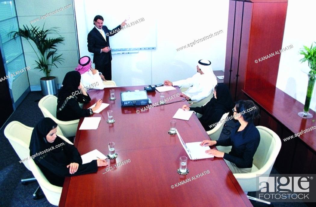 Stock Photo: Meeting of Arab businesspeople in boardroom.