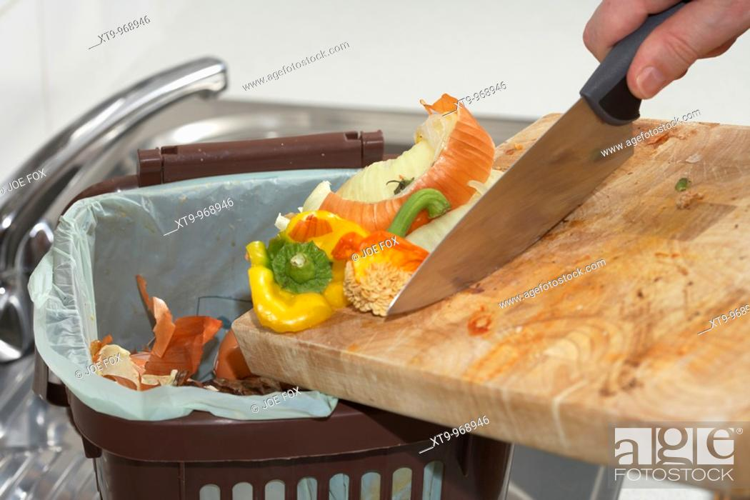 Stock Photo Sing Organic Kitchen Ss Into A Home Compost Food Recycling Bin In The Uk