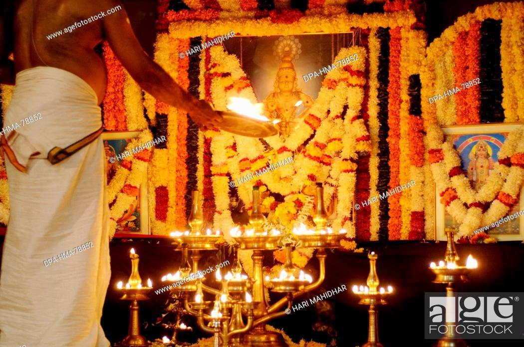 Indian man doing worship of Lord Ayyappa Pooja