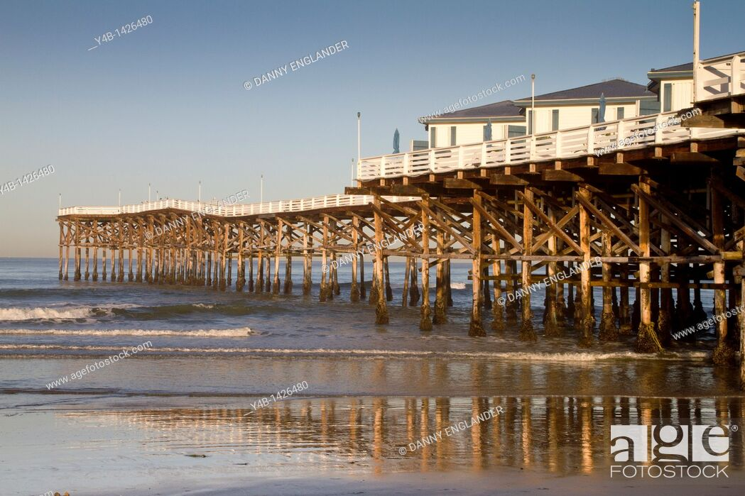 Stock Photo: Cottages and pier at sunset, Crystal Pier Hotel, Pacific Beach, San Diego, California.