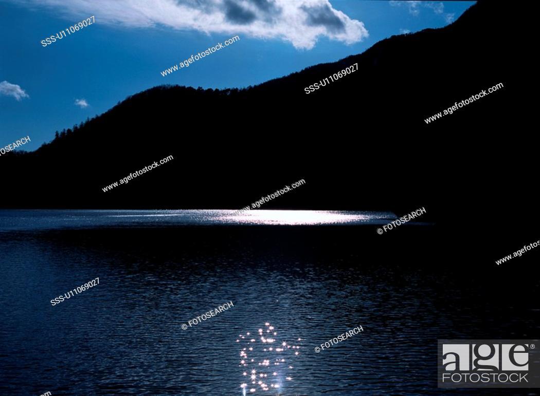Stock Photo: Reflections On Lake Yunoko.