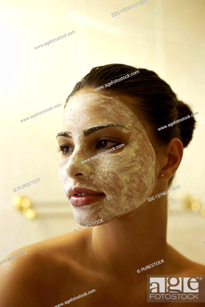 Stock Photo: Close-up of a young woman with a facial mask.