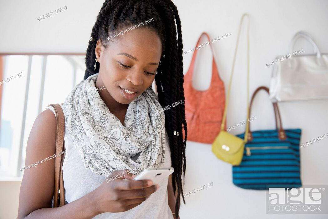 Stock Photo: Black woman using cell phone.