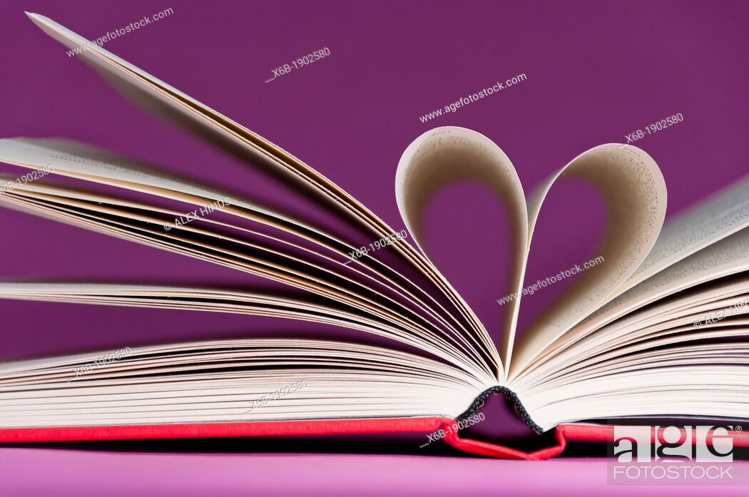 Stock Photo: Book pages folded together into a heart shape.