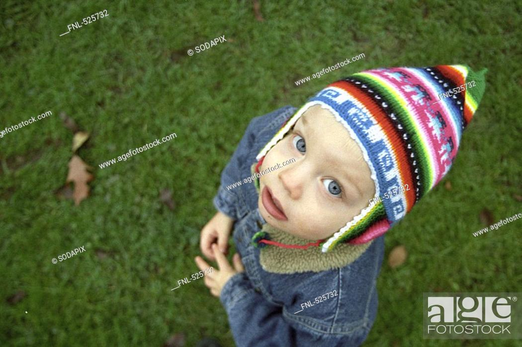 a38a65eb3fc0 Stock Photo - Boy Child toddler Ben Color colored play Game playing Cap  Peruvian cap In the open air outdoors looking up blue eyes Look expectant  hopeful ...