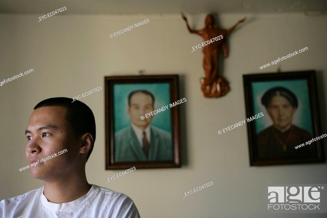 Stock Photo: Teenage boy 15-17 with picture frames in background.