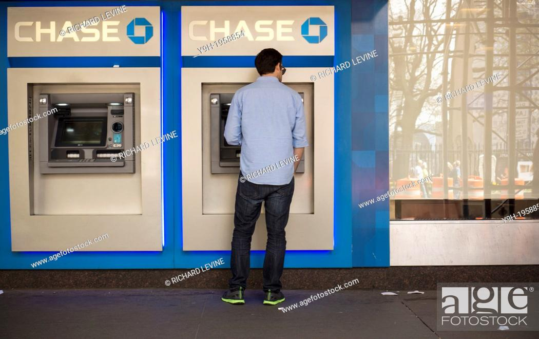 Customer uses the ATM machines at a JPMorgan Chase bank in