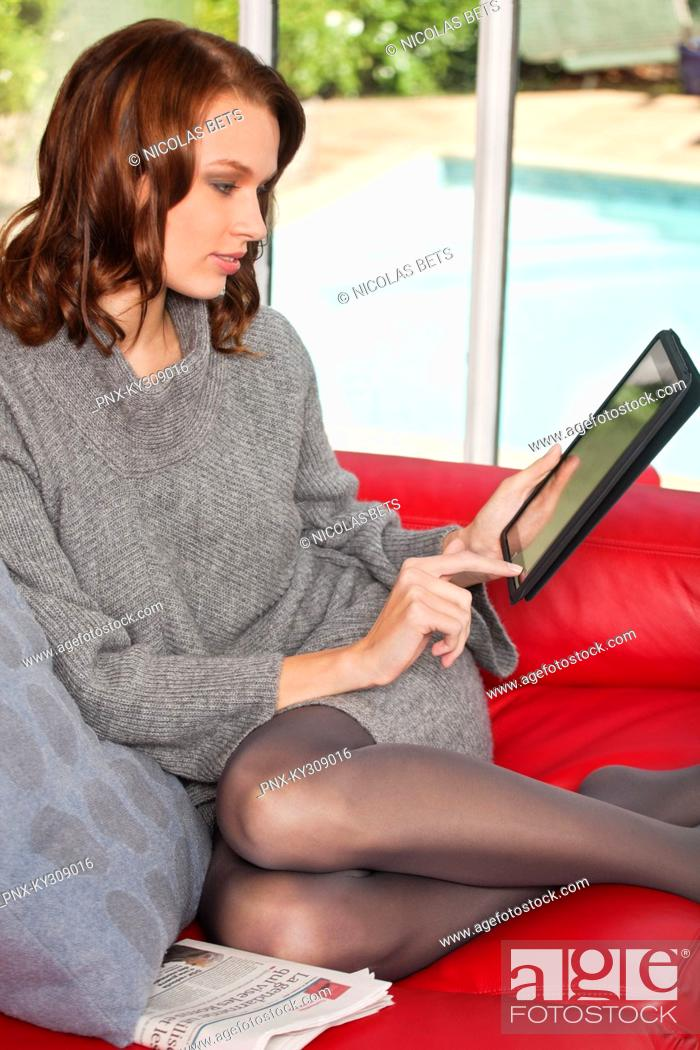 Stock Photo: Young woman using iPad.